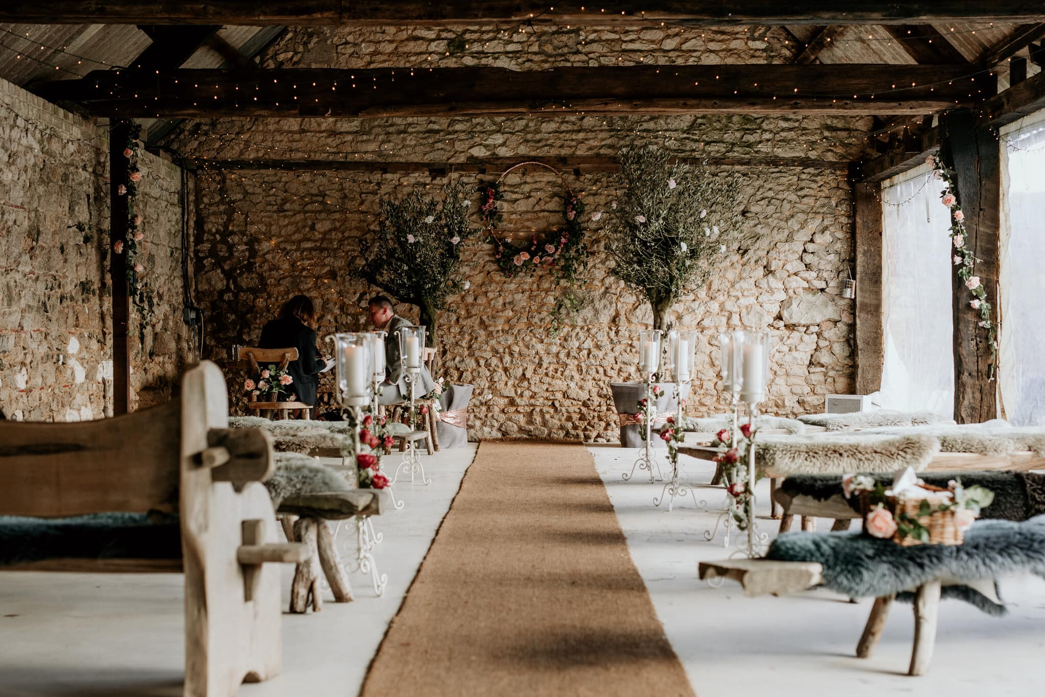 Wedding ceremony set up in rustic barn at East Afton Farmhouse